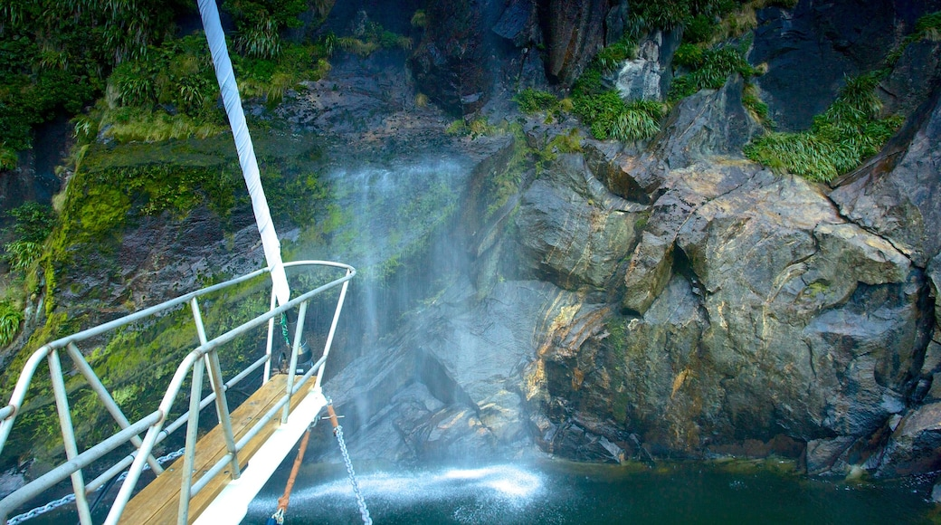 Milford Sound featuring a cascade, a river or creek and boating