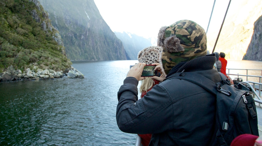 Milford Sound which includes mountains, a river or creek and boating