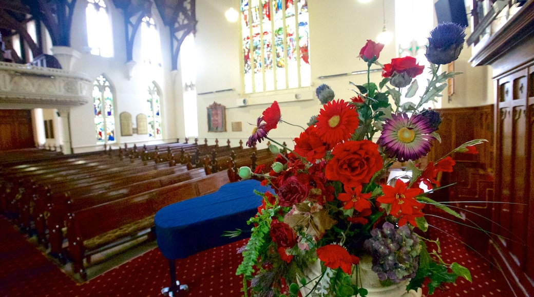 First Church of Otago featuring a church or cathedral, flowers and interior views