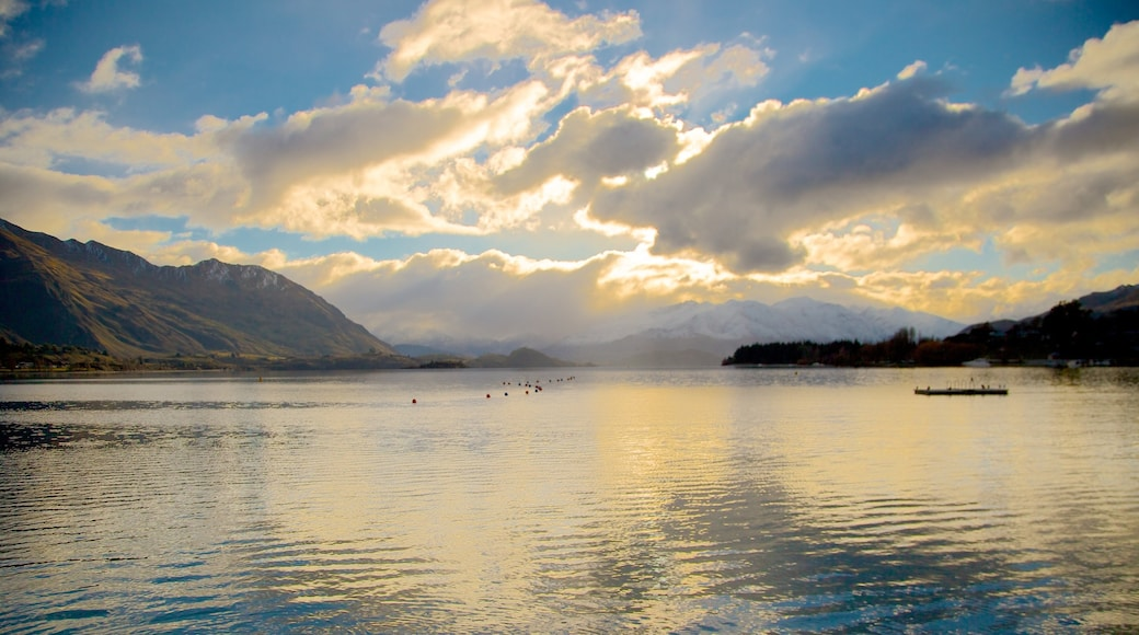 Lake Wanaka which includes a lake or waterhole and a sunset