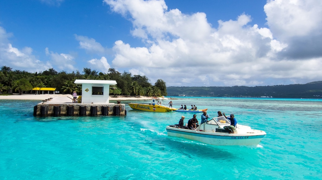Saipan showing general coastal views and boating as well as a small group of people