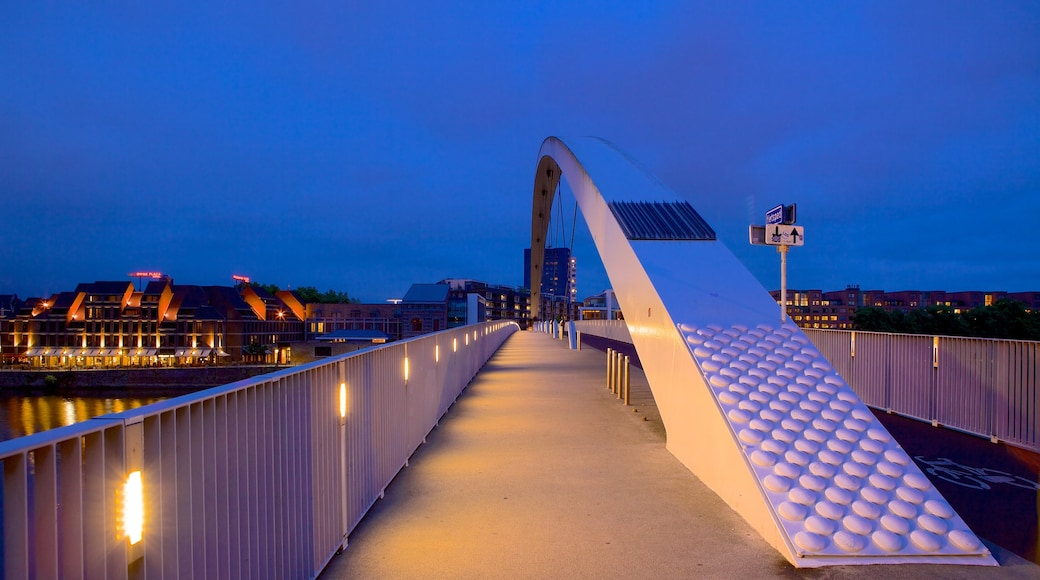 Maastricht which includes modern architecture, a bridge and night scenes