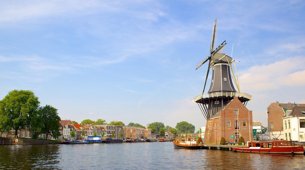 Haarlem showing a windmill and a river or creek