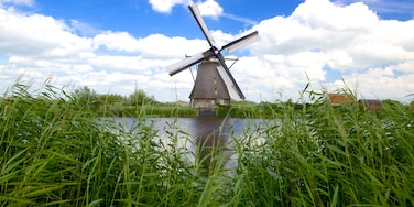 Kinderdijk featuring a river or creek and a windmill