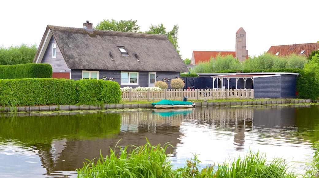 Kinderdijk featuring maatila, talo ja joki tai puro