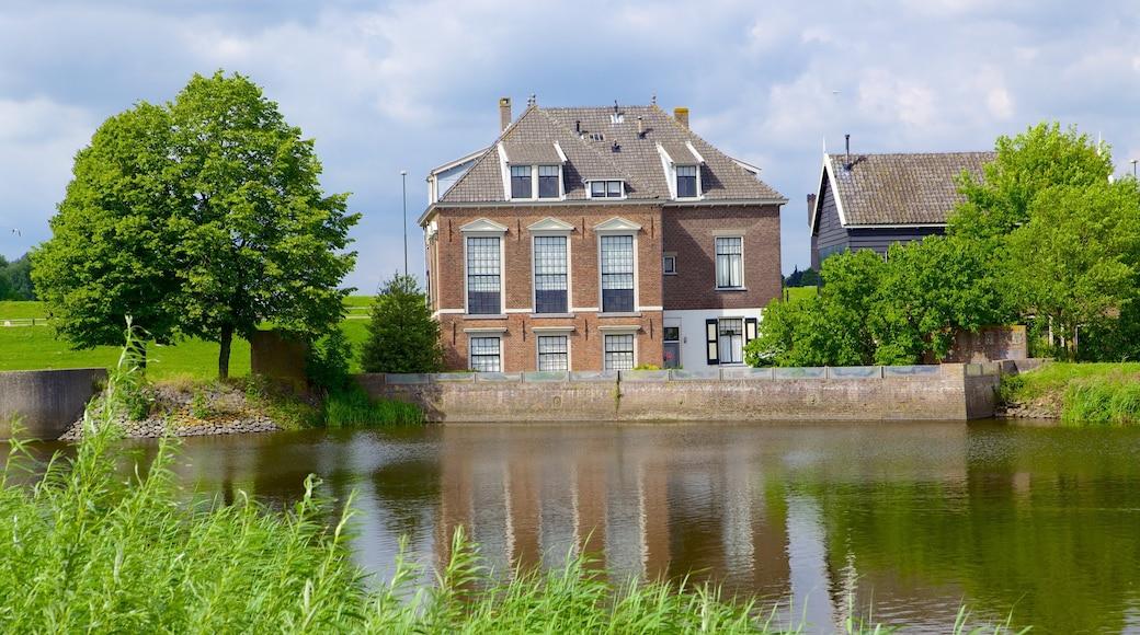 Kinderdijk featuring joki tai puro ja talo