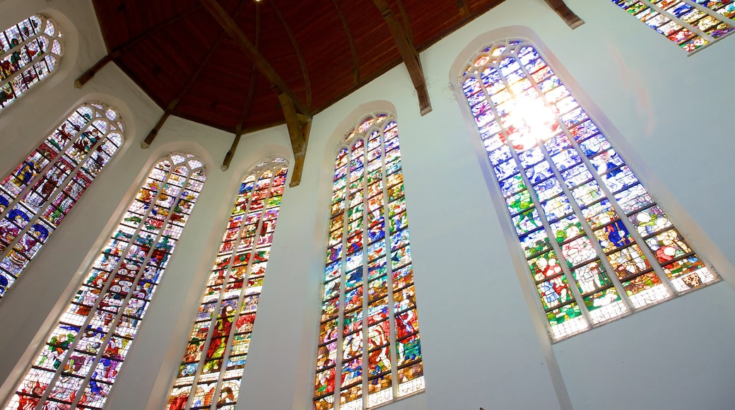 Oude Kerk featuring a church or cathedral, religious elements and interior views