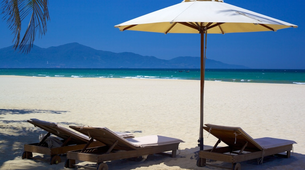 Non Nuoc Beach showing a sandy beach, tropical scenes and a luxury hotel or resort