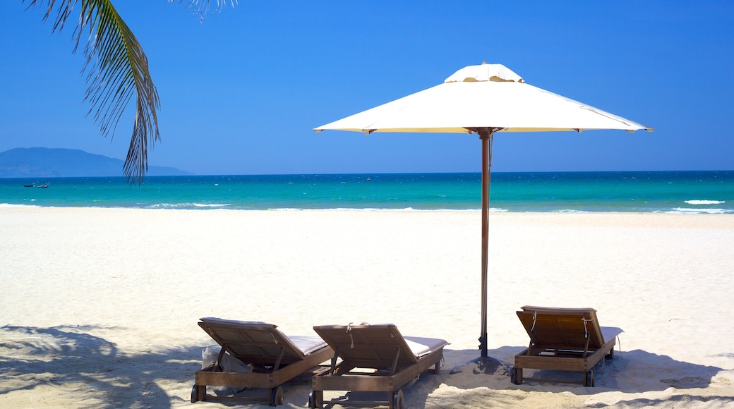 Non Nuoc Beach featuring tropical scenes, a sandy beach and a luxury hotel or resort
