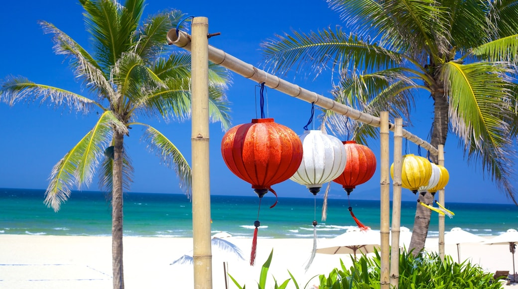 Non Nuoc Beach showing tropical scenes and a beach