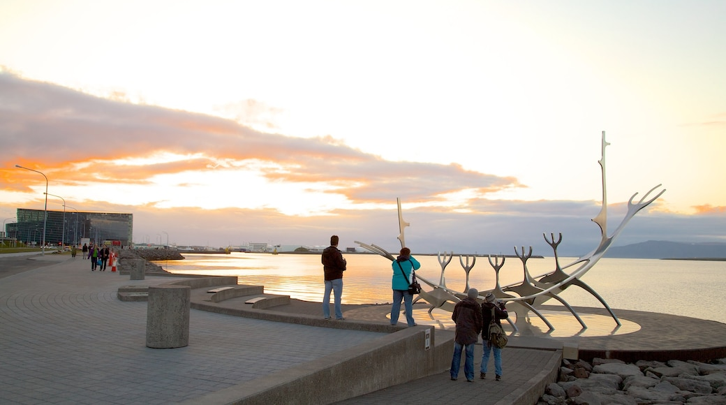 Reykjavik Harbour which includes general coastal views, outdoor art and a sunset