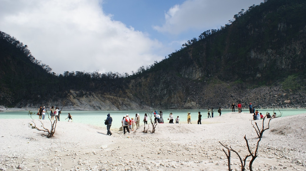 Bandung featuring a lake or waterhole and hiking or walking as well as a large group of people