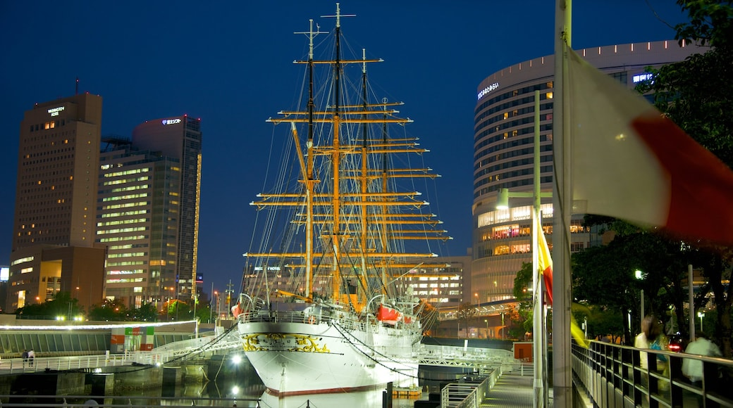 Yokohama showing sailing, a bay or harbour and night scenes