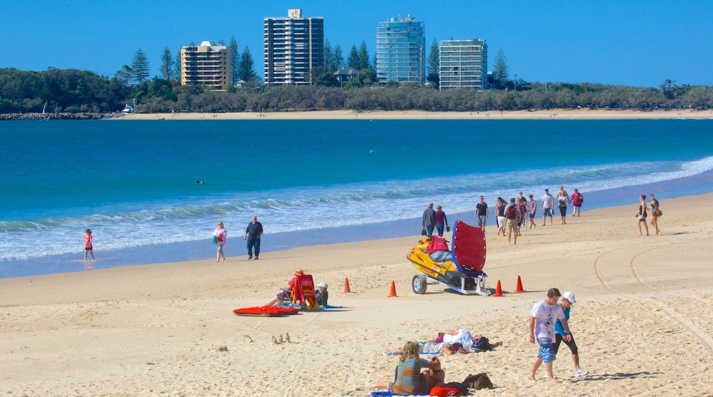 Mooloolaba Beach featuring a sandy beach as well as a large group of people