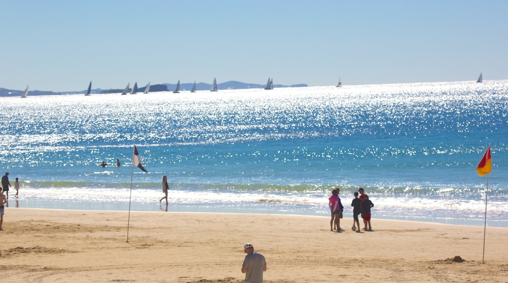 Mooloolaba Beach which includes a beach as well as a large group of people