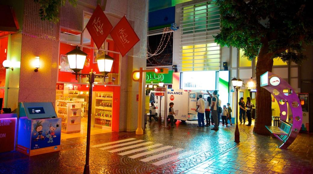 KidZania showing night scenes, rides and street scenes