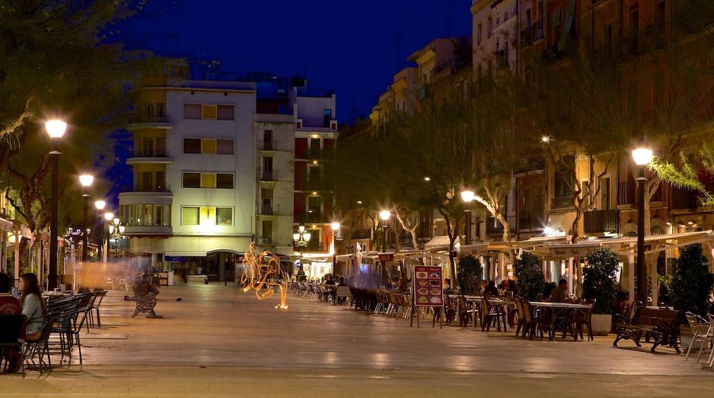 Tarragona which includes night scenes and street scenes