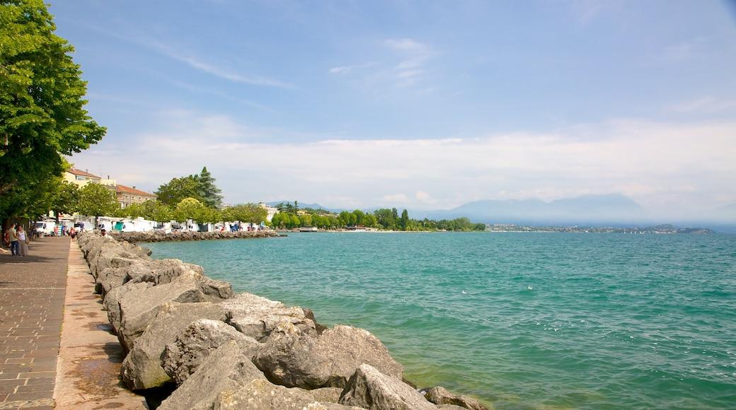 Desenzano del Garda which includes general coastal views and rocky coastline