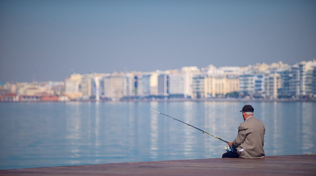 Thessaloniki featuring general coastal views and fishing as well as an individual male