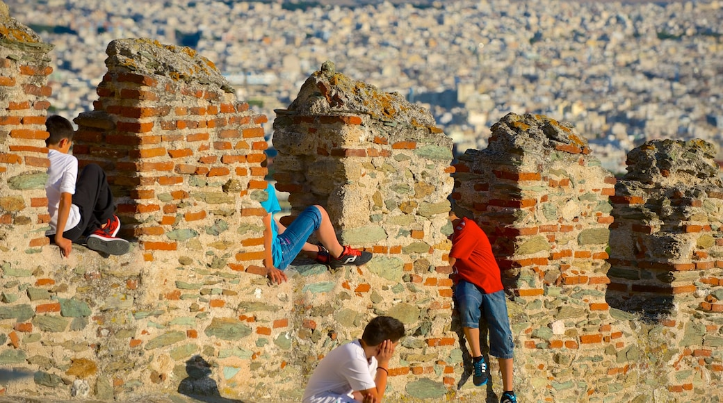 Byzantine Walls featuring a ruin and heritage elements as well as a small group of people