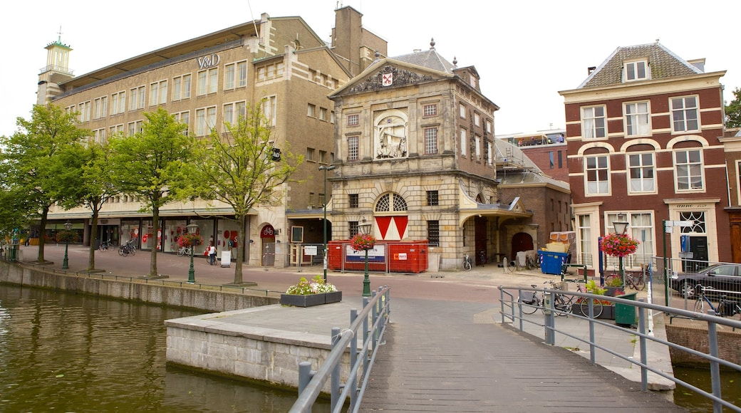 Waag which includes a bridge, heritage architecture and street scenes