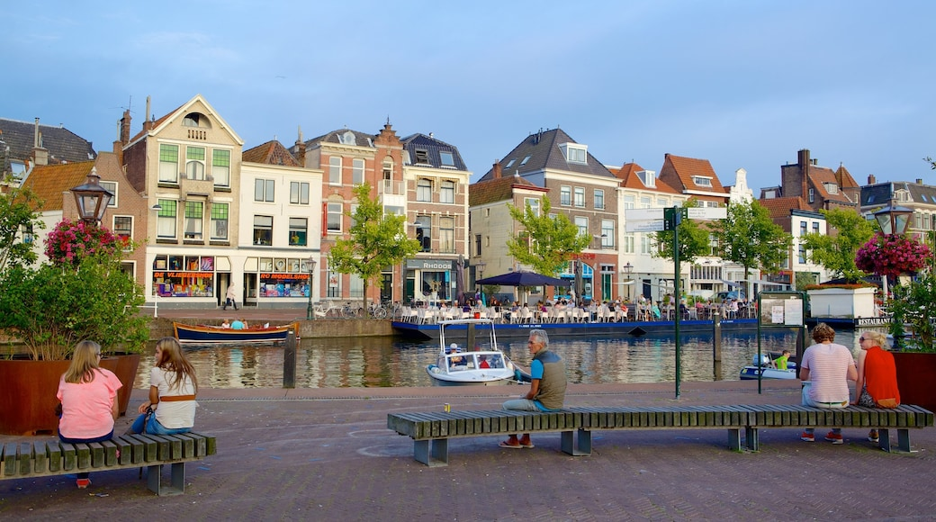 Beestenmarkt which includes street scenes as well as a large group of people