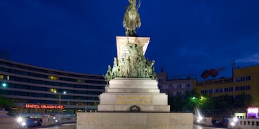 Monument to the Liberating Tsar featuring a statue or sculpture, night scenes and a square or plaza