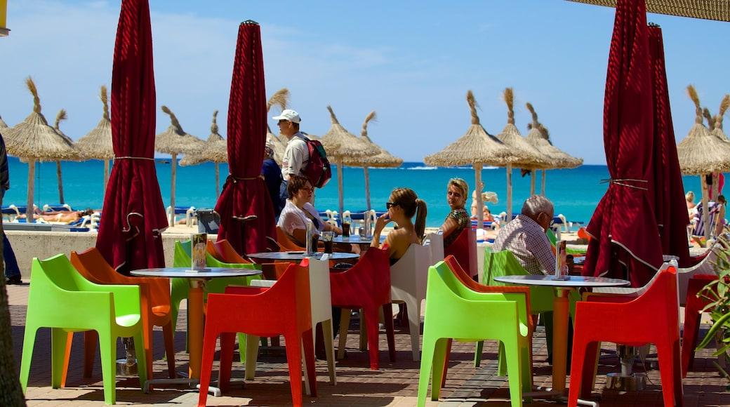 Palma de Mallorca ofreciendo vistas de una costa y comidas al aire libre y también un grupo grande de personas