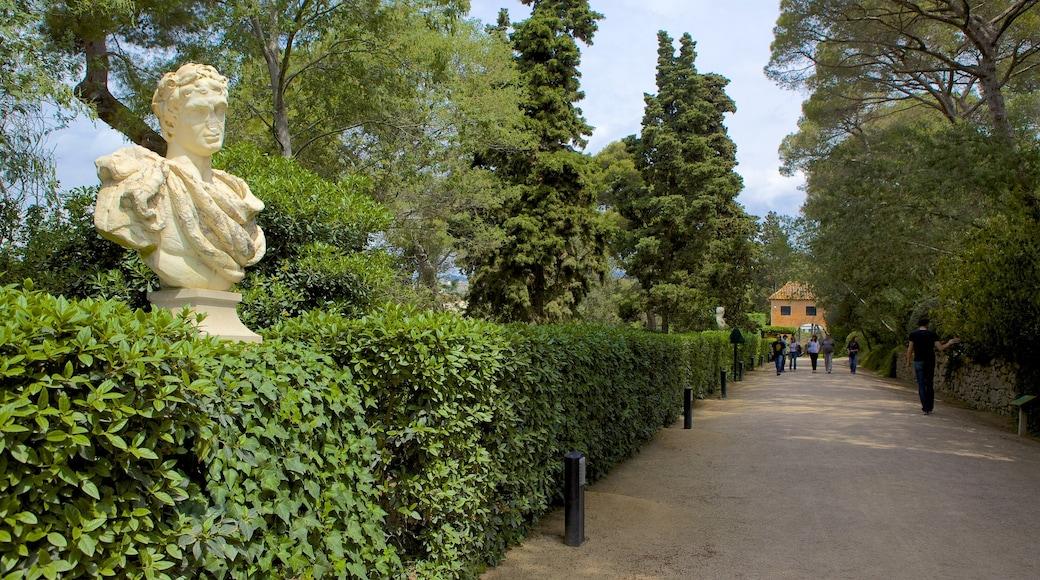 Santa Clotilde Gardens featuring a park, a statue or sculpture and outdoor art