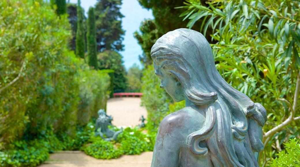 Santa Clotilde Gardens featuring a statue or sculpture, outdoor art and a garden