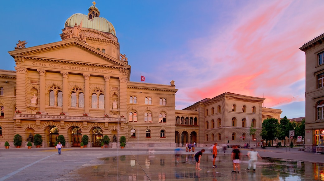 Bundeshaus showing a sunset, an administrative building and a square or plaza