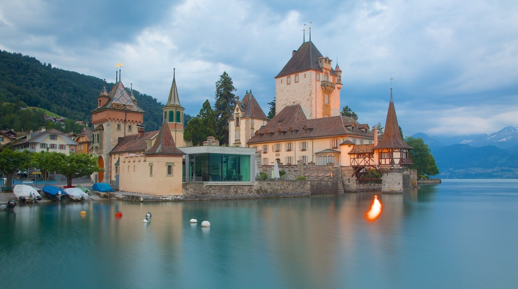 Interlaken featuring heritage architecture, a castle and a lake or waterhole