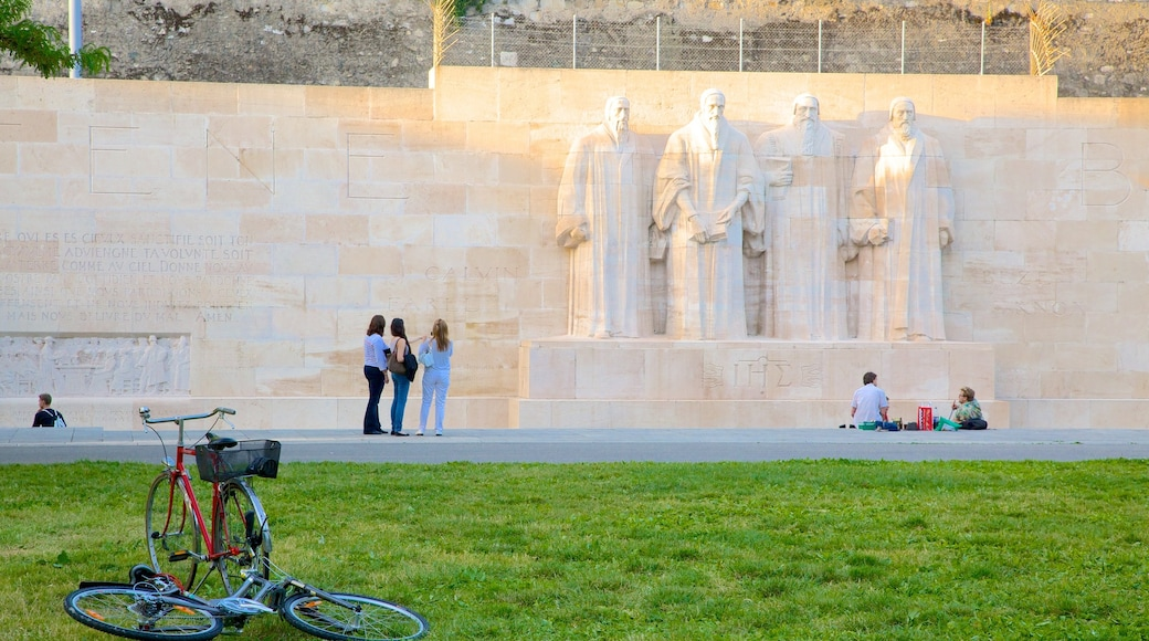 Reformation Wall Monument featuring a statue or sculpture and a monument as well as a large group of people