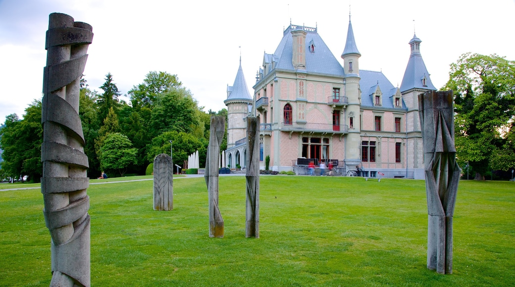 Schadaupark showing outdoor art, a garden and chateau or palace