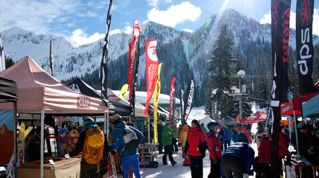 Whitewater Ski Resort which includes mountains and snow as well as a large group of people