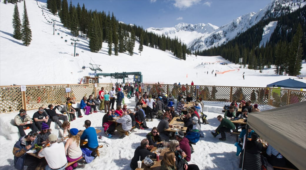 Whitewater Ski Resort featuring snow as well as a large group of people