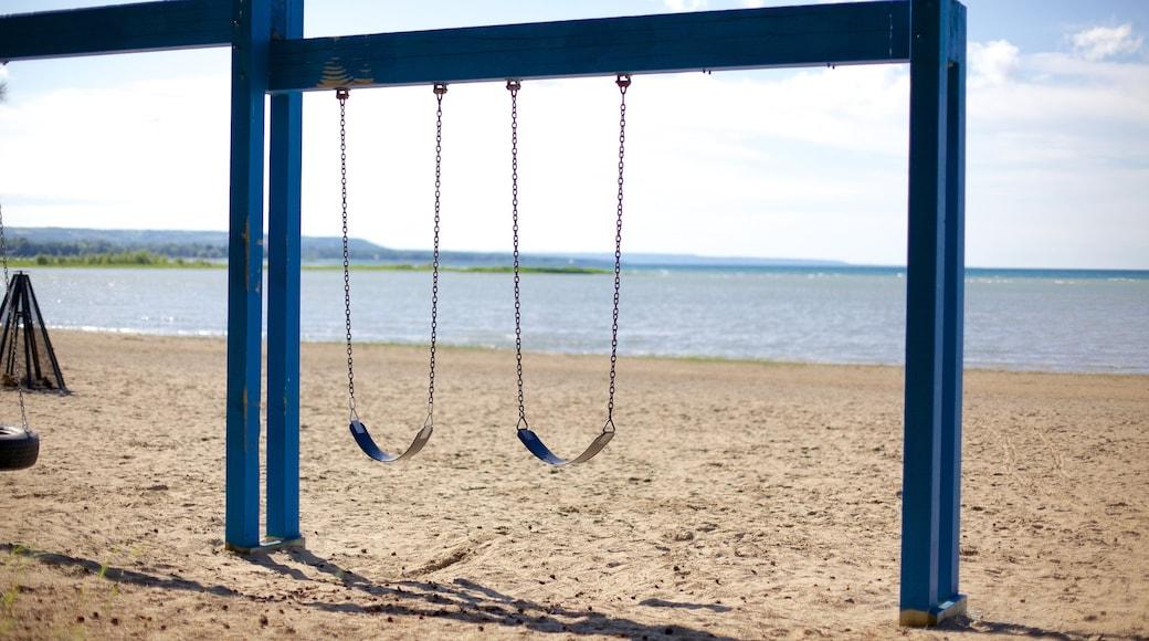 Blue Mountain Beach showing a playground and a sandy beach