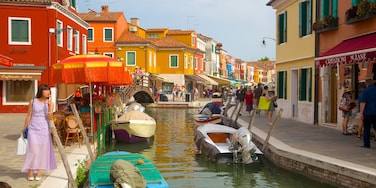 Burano featuring a river or creek and heritage architecture