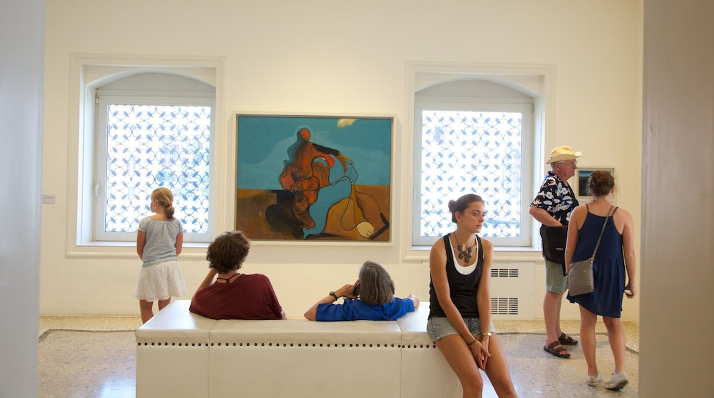 Peggy Guggenheim Museum which includes art and interior views as well as a small group of people