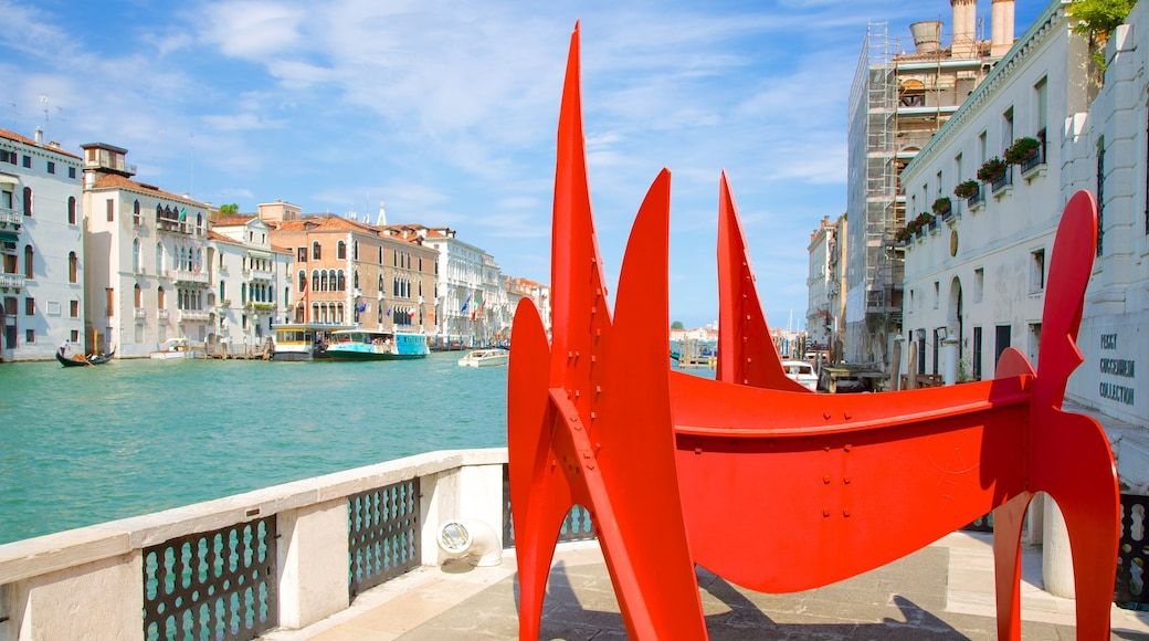 Peggy Guggenheim Museum showing outdoor art and a river or creek