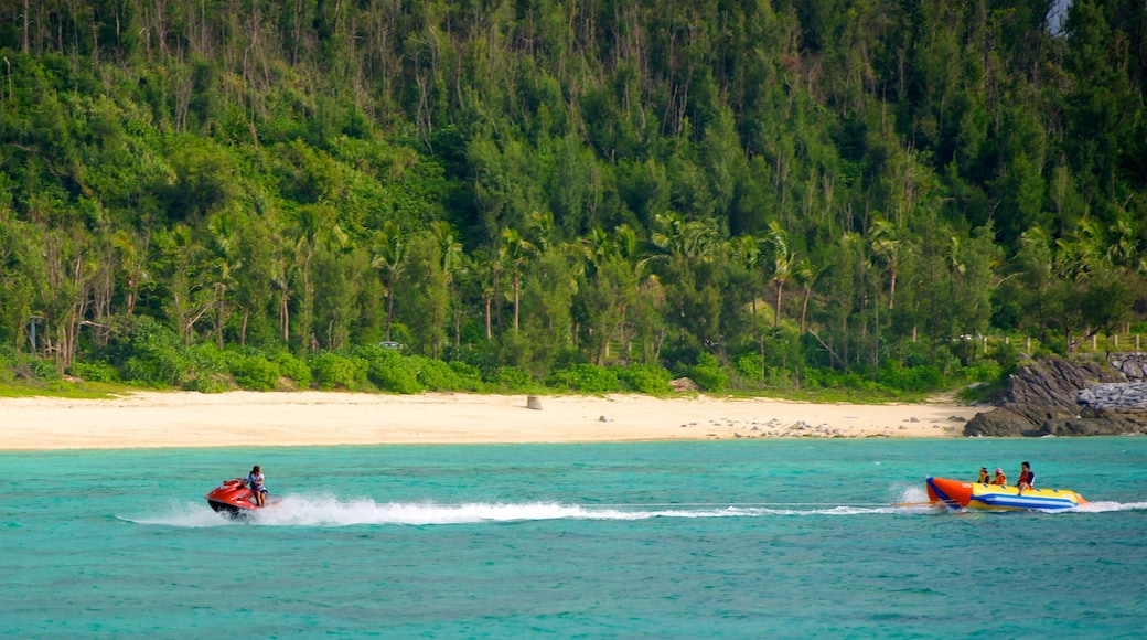Busena Marine Park featuring a sandy beach, tropical scenes and jet skiing
