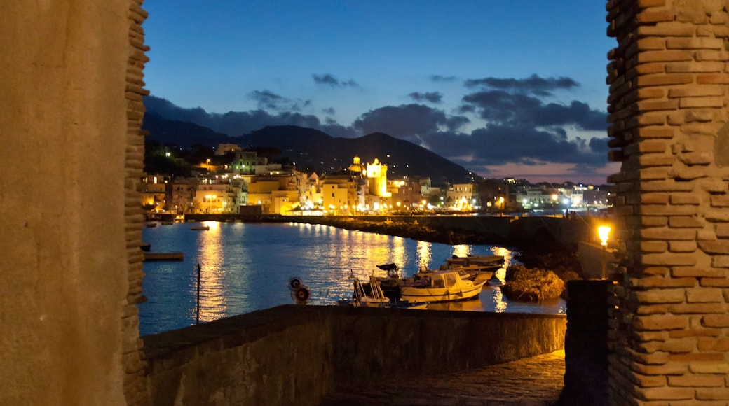 Ischia showing night scenes, a coastal town and a river or creek
