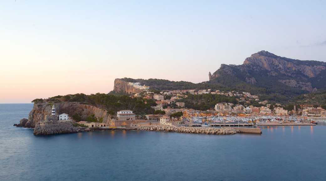 Port de Soller Lighthouse featuring a coastal town, general coastal views and a bay or harbour