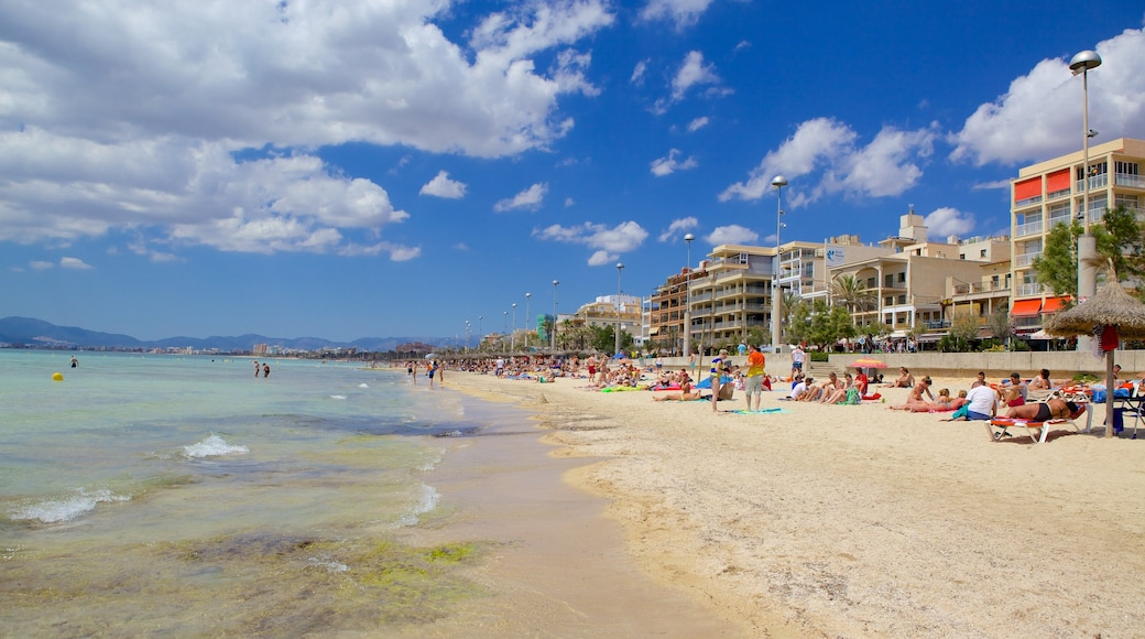 El Arenal which includes a coastal town and a sandy beach as well as a large group of people