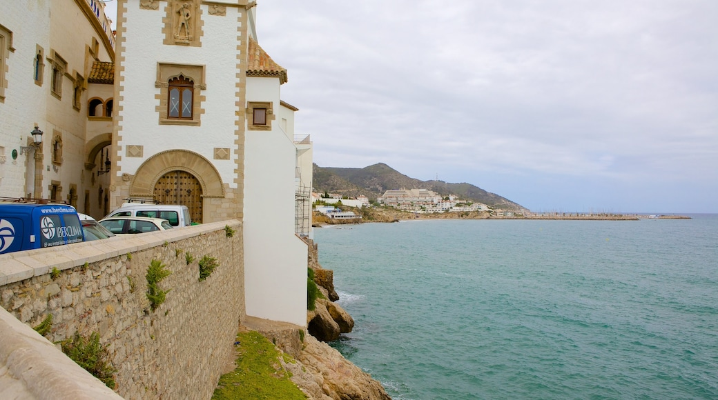 Sitges featuring heritage architecture and rugged coastline