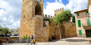 Alcudia featuring building ruins, heritage architecture and château or palace