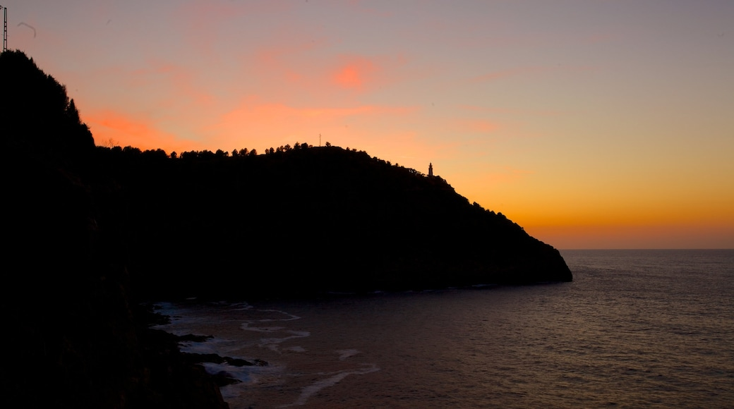 Port de Soller Lighthouse which includes general coastal views and a sunset