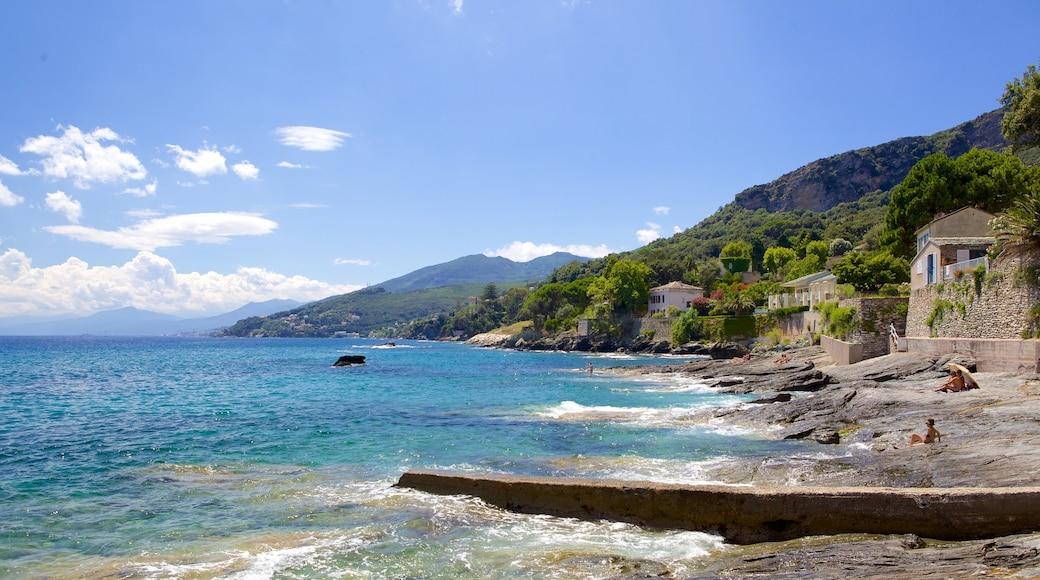 Brando which includes rocky coastline