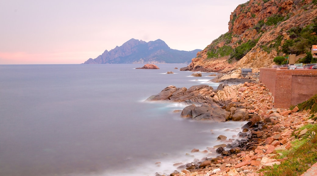 Genoese Tower showing rugged coastline and a sunset