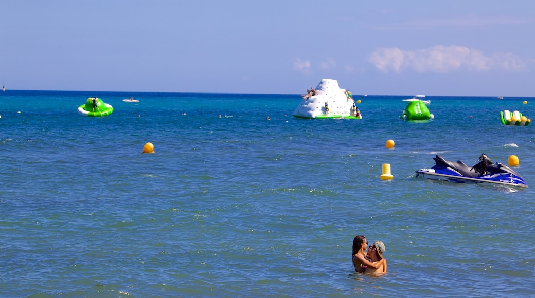 L\'Arinella Beach featuring swimming as well as a couple
